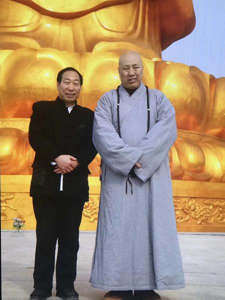東林寺主持大安法師與程育全大師合影