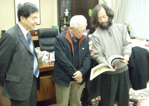 与民革中央主席周铁农、副主席何丕杰先生